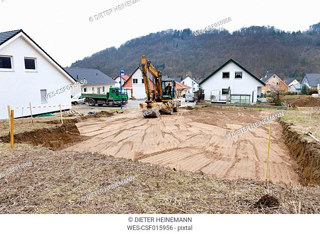 Europe, Germany, Rhineland Palatinate, Man preparing ground for house foundation