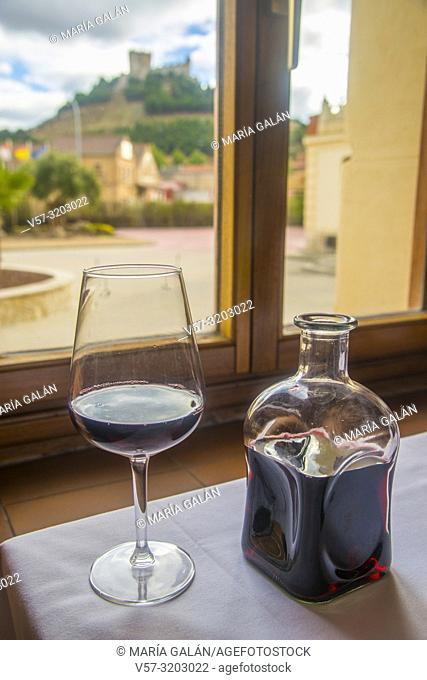 Glass and bottle of Ribera del Duero red wine. Peñafiel, Valladolid province, Spain