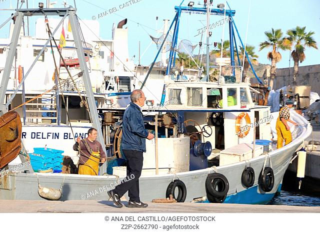 VILLAJOYOSA PORT, SPAIN - JANUARY 13, 2016: It comes time to sell the fish caught. Trawlers of La Vila harbor are entering to their moorings in Alicante Spain