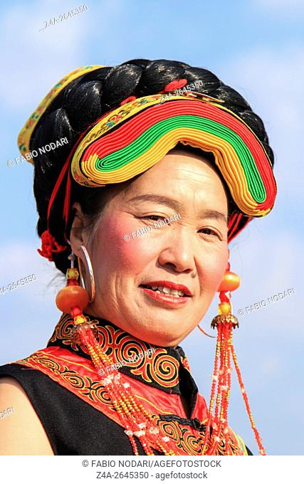 Heqing, China - March 15, 2016: Chinese girl in traditional Miao clothing during the Heqing Qifeng Pear Flower festival