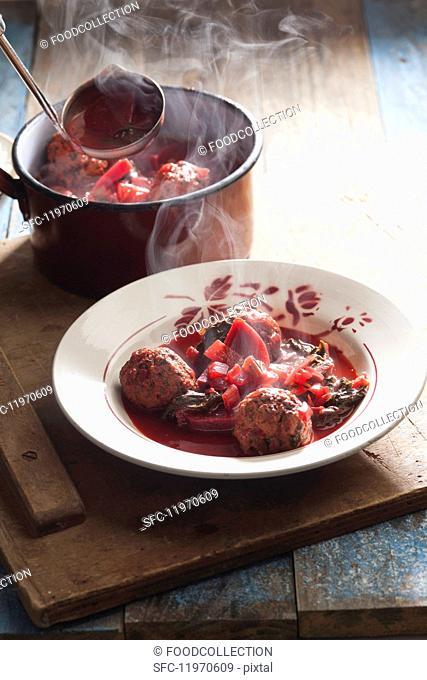 Steaming beetroot soup with meat dumplings
