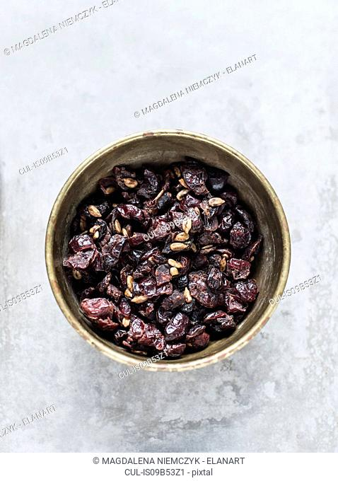 Studio shot, overhead view of dried fruit in bowl