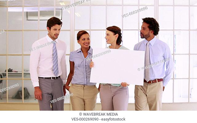 Business team showing a white card