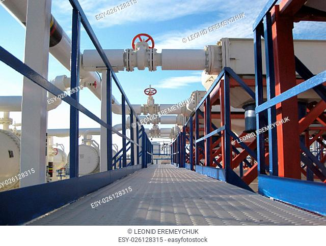 Steel service platform and stairs. Equipment refinery