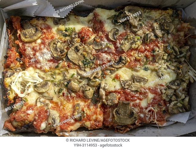 Mushroom topped Detroit style deep dish pizza, from the newly opened Lions & Tigers & Squares pizzeria in Chelsea in New York on opening day, Tuesday, May 1