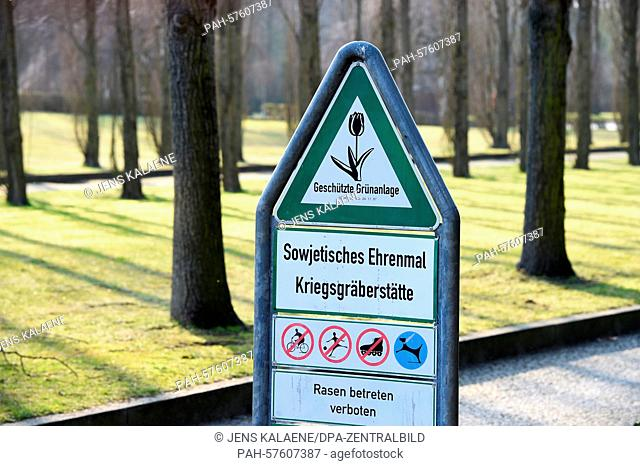 Signs on the premises of the Soviet War memorial in Treptower Park that read 'Soviet Memorial Gravesite,' 'Protected green space, 'Do not enter the lawn