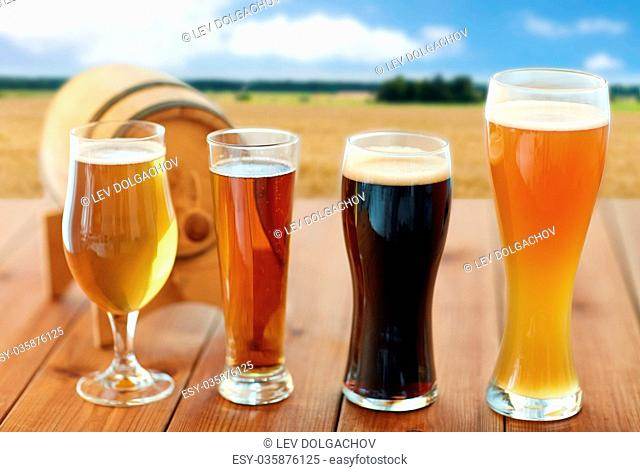 different types of beer in glasses on table