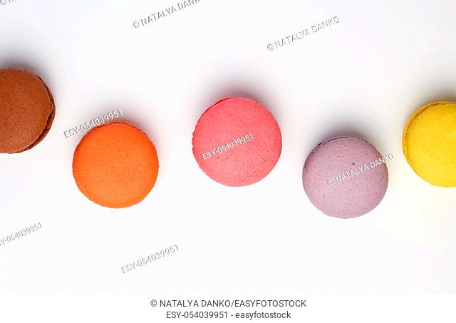 colorful baked macaron almond flour on a white background, flat lay