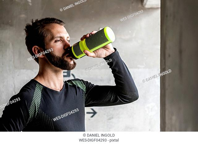 Portrait of athlete drinking from bottle