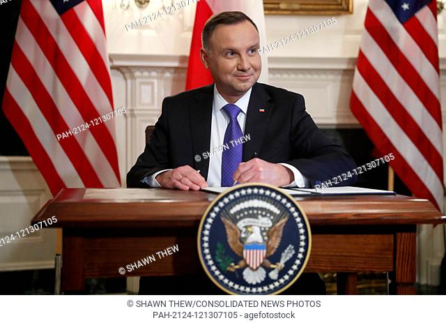 US President Donald J. Trump (not pictured) and Polish President Andrzej Duda participate in a signing ceremony in the Diplomatic Reception Room of the White...