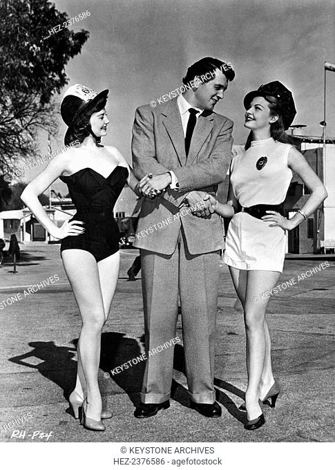 Rock Hudson (1925-1985) with starlets Jackie Loughery (1930-) and Mary Castle (1931-), California, USA, c1950s