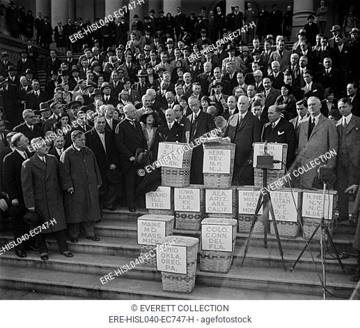 Congress gets huge petition for reduction of federal tax on earned incomes in Dec. 1929. The petition was received by chairmen of the House and Senate Finance...