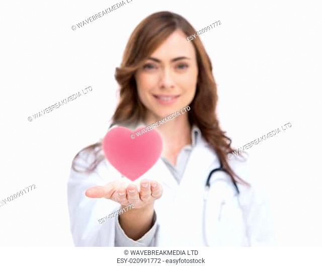 Doctor holding a pink heart