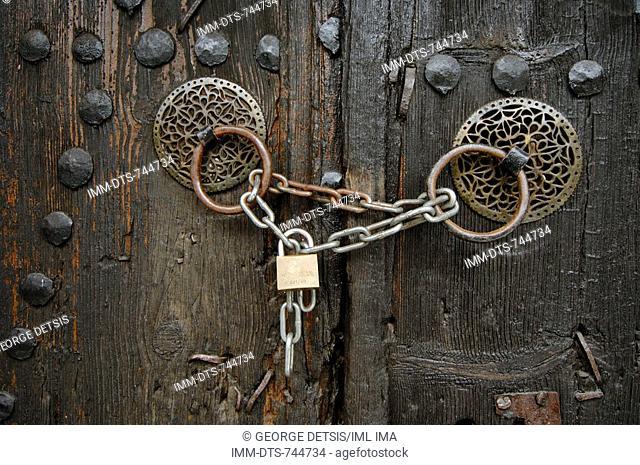 Locked door handles. Monodendri, Zagorohoria, Ioannina, Greece, Europe