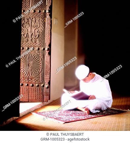 Ramadan: Young boy reading the Quran