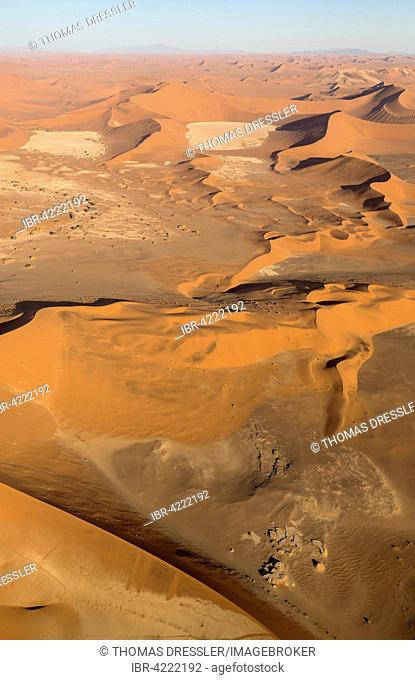 Sand dunes in the Namib Desert, top centre the so-called Dead Vlei, dry pan in the centre of the Namib Desert, in the evening, aerial view