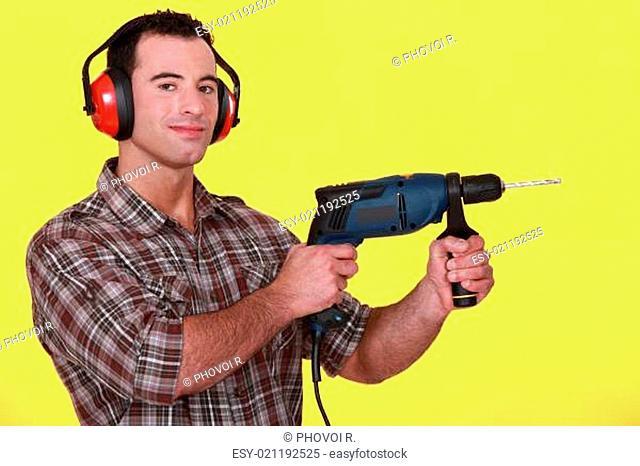 Man holding an electric screwdriver