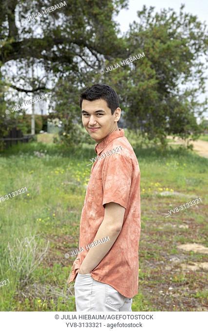 A 22 year old man looking into the camera, Carlsbad, California