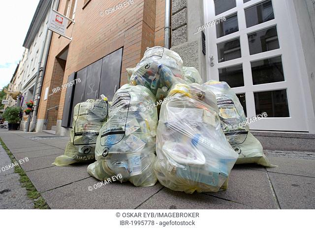 Yellow bags before collection by the garbage collection, Brennerstrasse, Stuttgart, Baden-Wuerttemberg, Germany, Europe