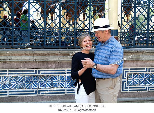 Couple, 65, by a bandstand, the Morisco Kiosk, in Alameda de Santa Maria La Ribera, plaza in Mexico City, Mexico