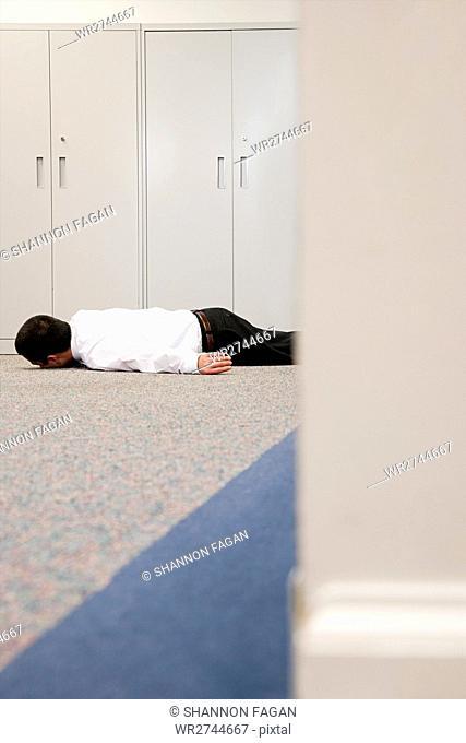 Man on floor of office