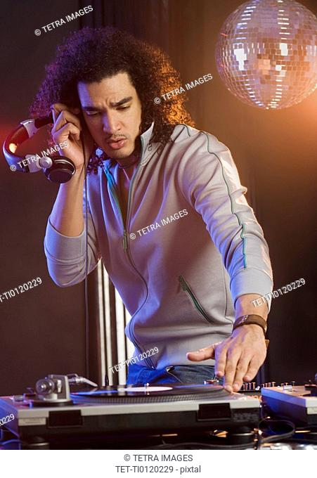 Man mixing sound at a dance club