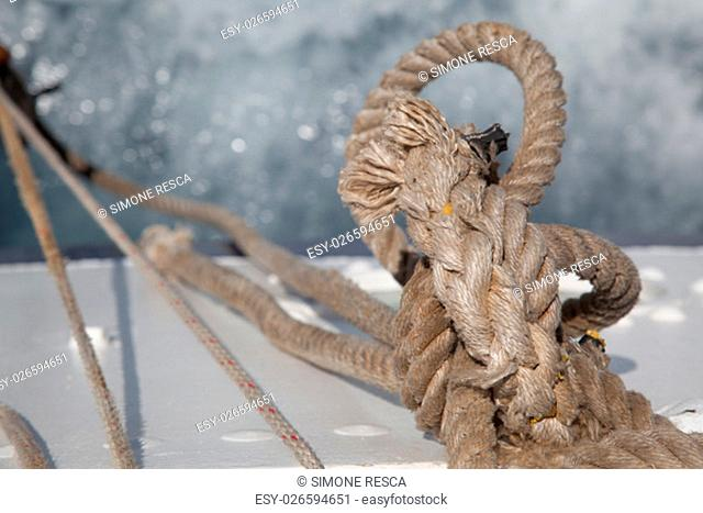 Rope knotted on itself with waves on a boat