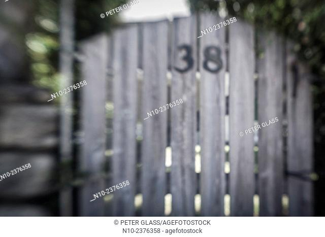 Wooden gate in front of a house