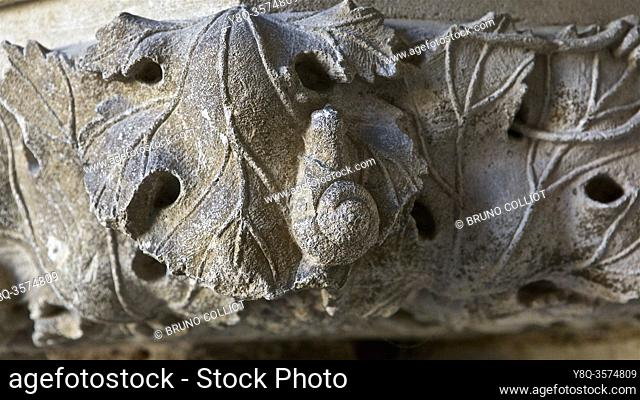 sculpted snails at the entrance to the abbey, St Seine l'Abbaye. France