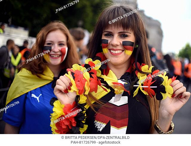 Marie-Angela (l) and Gina celebrating before the European Soccer Championship quarter finals match between Germany and Italy at the fan mile in front of the...