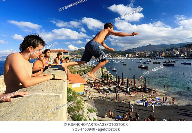 Boys diving from medieval bridge, Castro Urdiales, Cantabria, Spain
