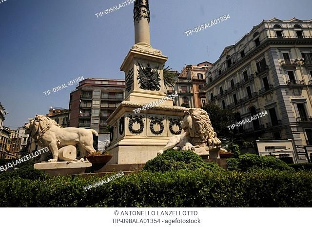 Italy, Campania, Naples, Chiaia quarter, the marble obelisk and lions, Piazza Martiri square