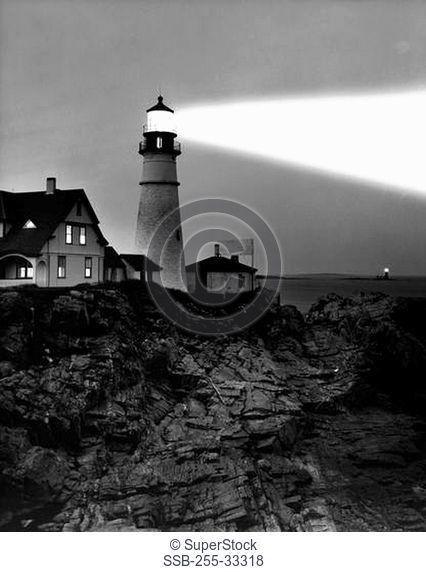 Low angle view of a lighthouse on the coast, Portland Head Lighthouse, Cape Elizabeth, Maine, USA