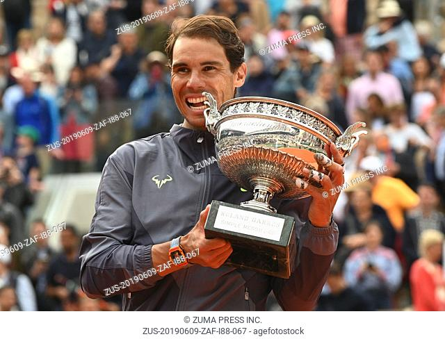June 9, 2019 - Paris, U.S. - PARIS, FRANCE - JUNE 09: .Rafael Nadal (ESP) poses with the trophy after defeating Dominic Thiem (AUT) in the men's singles...