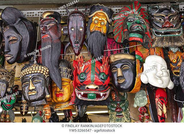 Selection of traditional religious and cultural facemasks for sale at Ben Thanh market, Ho Chi Minh City, Vietnam, Asia