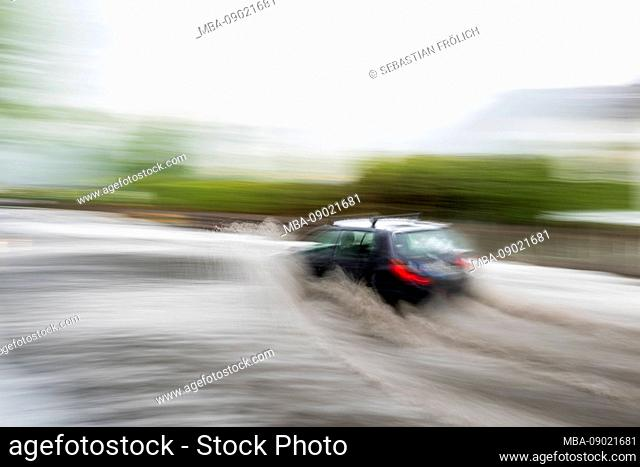 Bad weather with flooded street in Wallgau in the bavarian alps