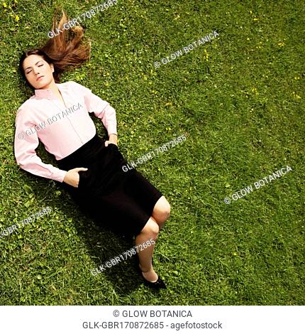 Teenage girl sleeping in a park