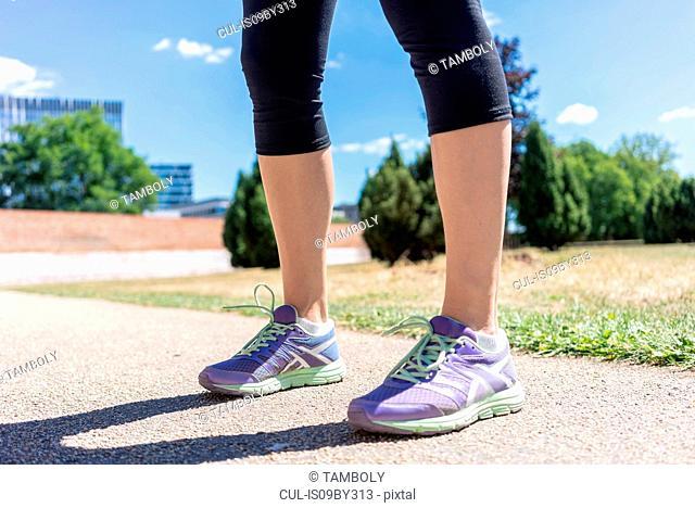 Feet of woman training in city park, Berlin, Germany