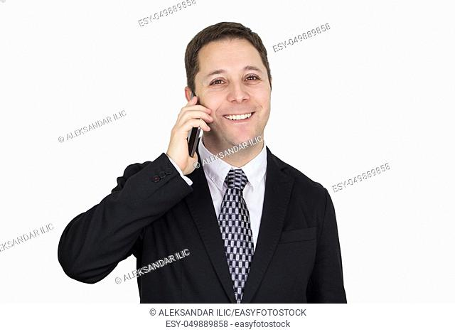 Businessman in Black Suit Talking On The Phone While Smiling and Feeling Happy Against White Background