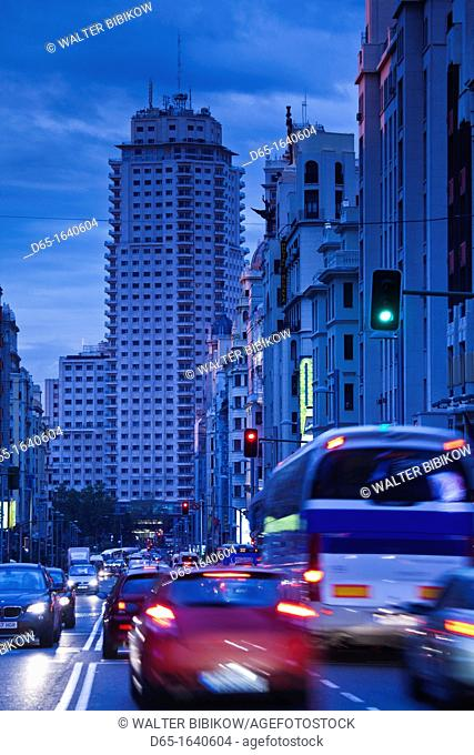 Spain, Madrid, Centro Area, Gran Via looking towards the Torre de Madrid and Plaza de Espana, dusk