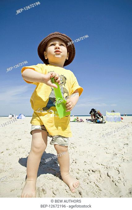 Child playing on the beach
