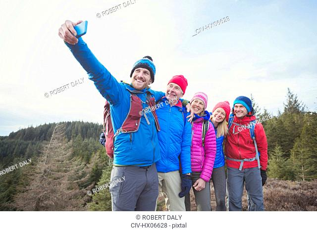 Family taking selfie in woods