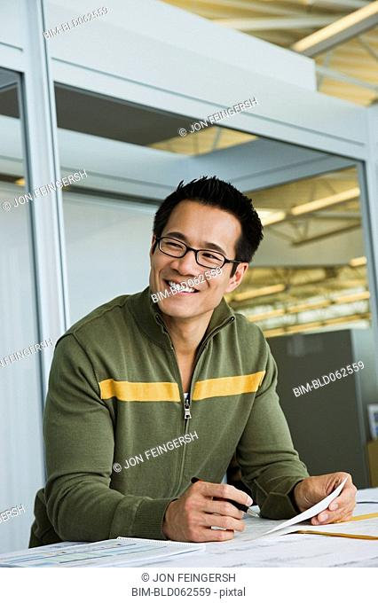 Asian American businessman working in office