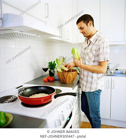 A man cooking in a kitchen