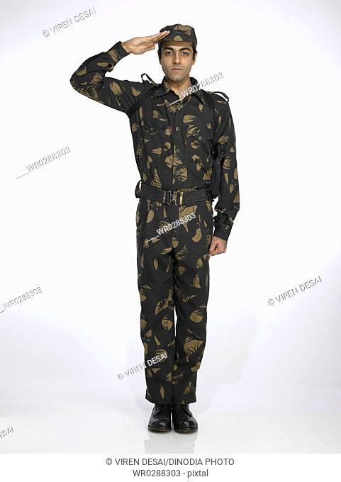 Indian army soldier standing in attention position and saluting MR702A