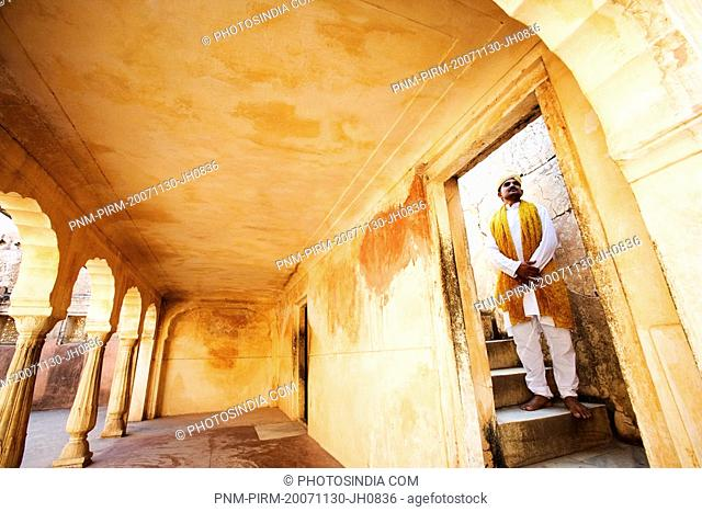 Man standing in a fort, Amber Fort, Jaipur, Rajasthan, India