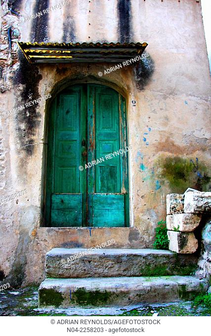 Turqouise doorway in the old section of Tropea, Calabria