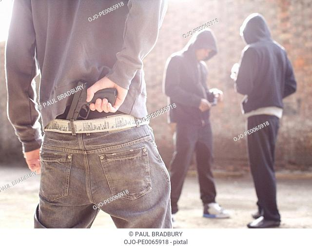 Man with gun robbing drug dealers