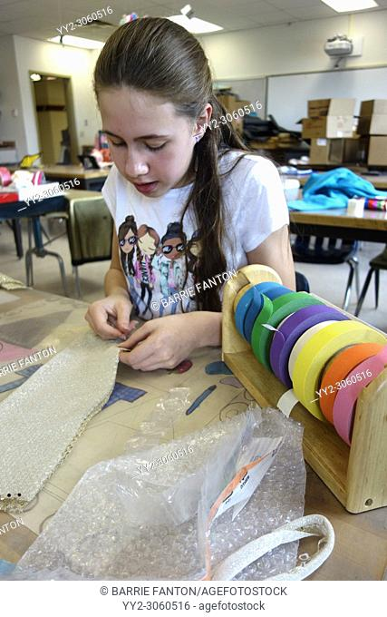 6th Grade Girl Working on Art Project, Wellsville, New York, USA