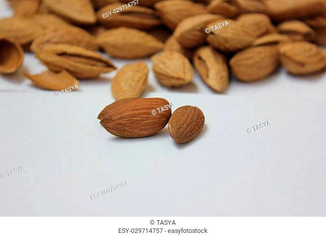 Almonds with shell on white background. Fresh nuts. A handful of nuts
